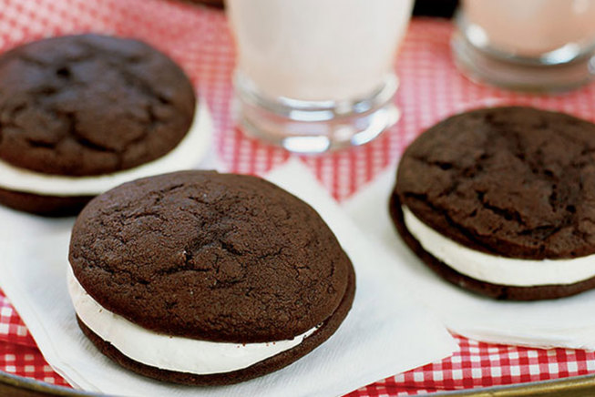 Two saucer-shaped rounds of chocolate cake sandwiched around a marshmallow-y cream.